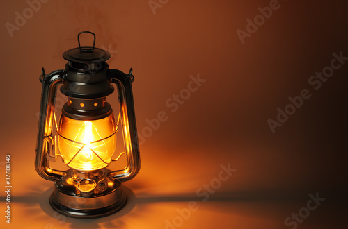 Burning kerosene lamp in dark, concept lighting