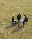 Business people having a meeting outdoors