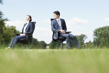 Business people sitting in chairs outdoors