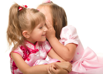 Two little girls are chatting