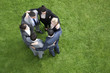 Business people hugging in circle outdoors