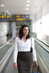 Businesswoman at the airport looking to the side