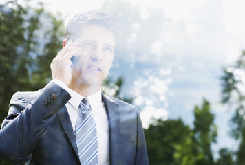 Businessman talking on cell phone and looking out window