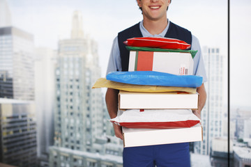 Deliveryman holding stack of packages