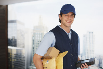 Deliveryman carrying packages and electronic device