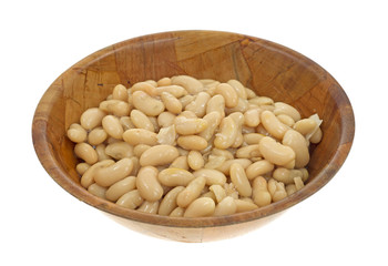 Serving of white beans in wood bowl