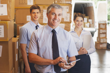 Business people standing together in warehouse