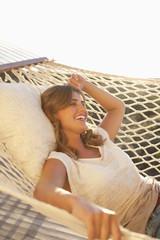 Smiling woman laying in hammock