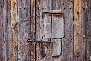Wooden door and iron lock of a typical Castilian village