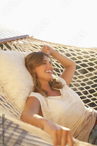 Smiling woman laying in hammock