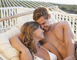 Couple laying in hammock together