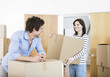 Couple bringing boxes to new home