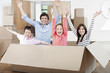 Family jumping out of moving box in new home