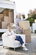 Couple unloading moving van