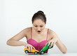Girl with toy cars