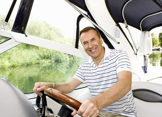 Man driving boat on river