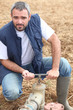 Farmer opening a water pipe