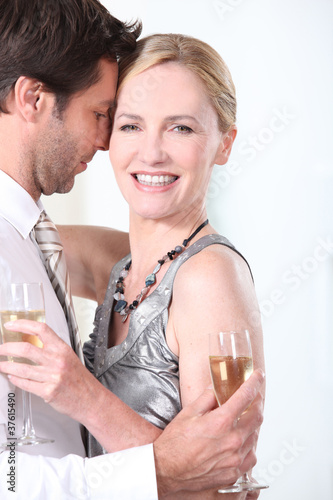 Couple smooching with champagne