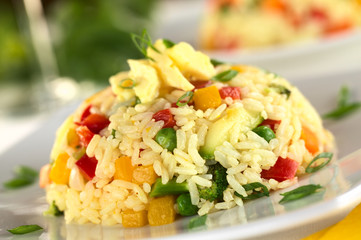 Vegetable risotto with scrambled egg on top