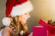 Beautiful woman surprise when opening christmas gift