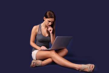 Modern young woman busy on laptop