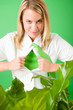 Superhero Businesswoman confident face green plant