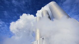 Steam From Geothermal Energy Plant Chimneys