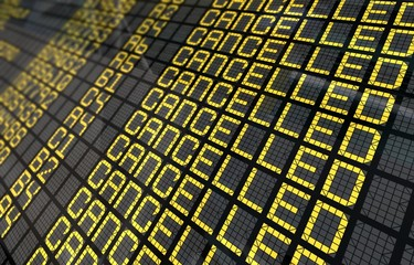 International Airport Board Close-Up with Cancelled Flights