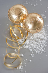 golden christmas balls with golden streamer