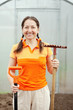 Happy  woman  with  garden tools in greenhouse