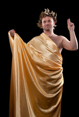 man dressed in Greek god
