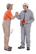 two craftsman painters shaking hands
