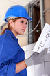 Female electrician with diagram