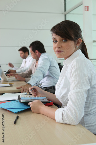Woman writing in her agenda