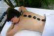 Older woman enjoying a hot stone massage