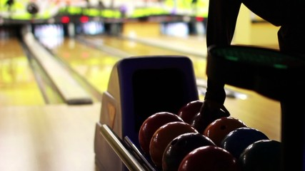 playing bowl in a bowling saloon