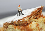Small hiker figure walk on cake with castor sugar imitating snow