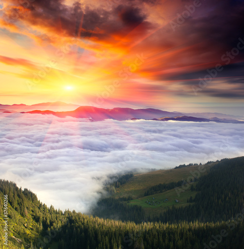 Panel Szklany Mountain landscape with cloudy sky and sun