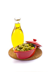 Olives and olive oil on white