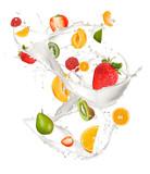 Mixed fruit in milk splash, isolated on white background