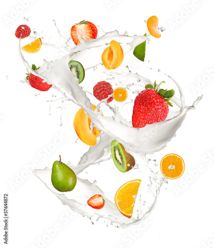 Mixed fruit in milk splash, isolated on white background