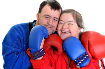 couple with down syndrome in boxing gloves on white