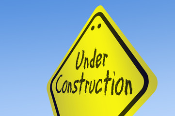 Under construction word on road sign