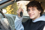 Teen driver behind the wheel with keys