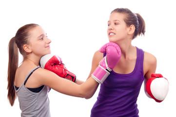 Pretty kick boxing teenage girls fighting