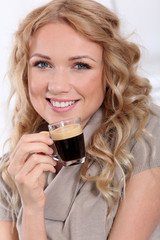 Portrait of blond woman drinking expresso