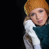 Portrait of beautiful woman wearing winter accessories
