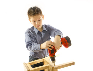 child with a screwdriver engaged in assembling furniture