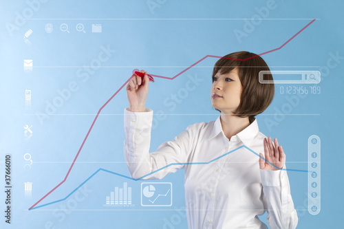 Beautiful business woman tocuhing on blue background