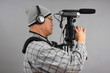 Man with HD SLR camera and audio equipment